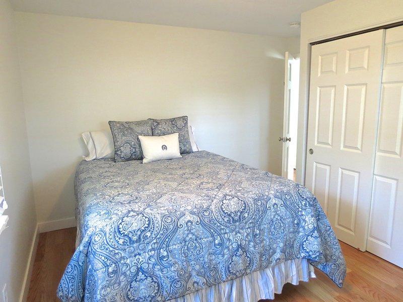 Bedroom two has a queen bed