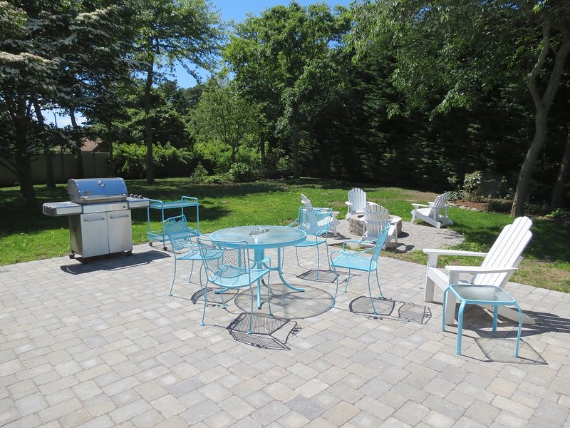 The over-sized patio overlooks the large yard