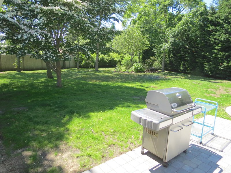 Fire up the grill, while the kids play in the large, level yard.