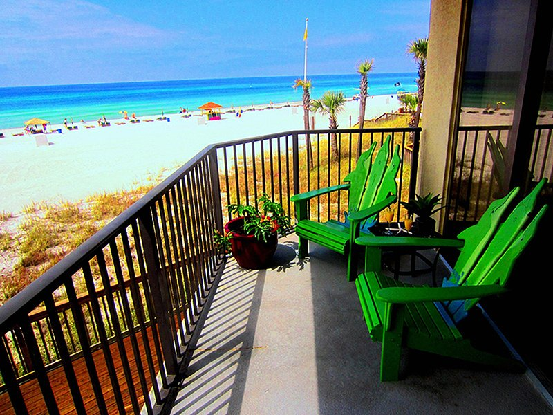 Come relax in our over the top dolphin Adirondack chairs. Handcrafted by a local artisan.