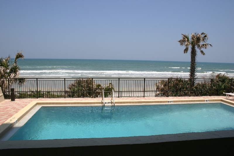 Oceanfront patio overlooking the pool and beach.  Walk right out to the pool and cool off in the refreshing pool.
