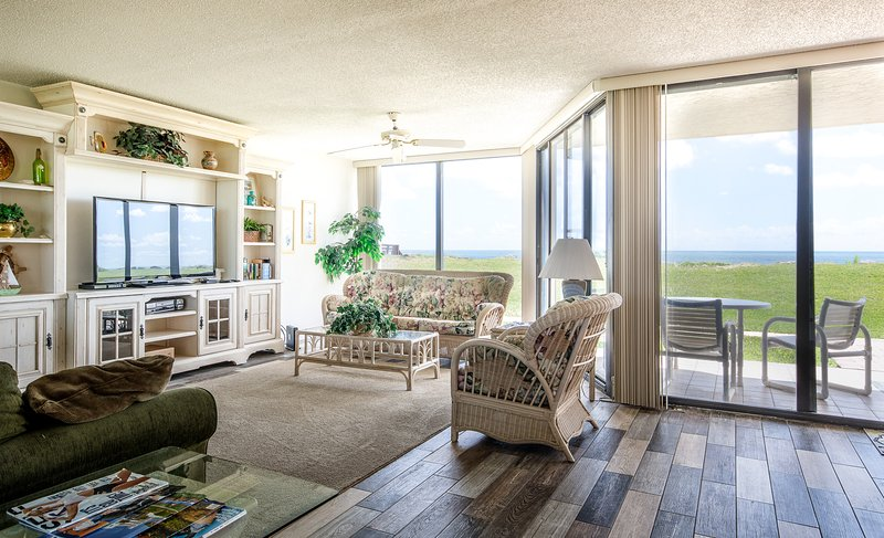 The oceanfront living room is spacious and features a TV, DVD, VCR and sofa sleeper.