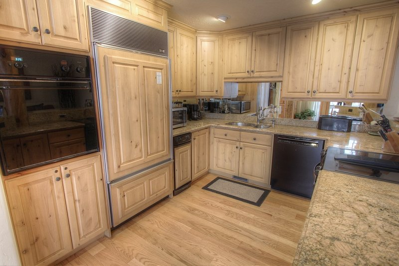 Gourmet Fully Equipped Kitchen with Granite Countertops and Sub Zero Refrigerator