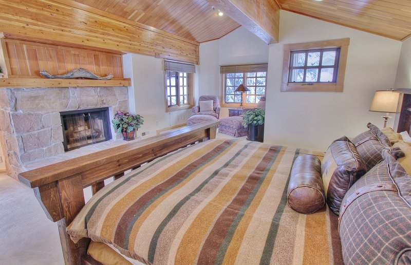 Grand Master Suite with King Bed, TV/DVD, Wood Fireplace, Sitting Area and Private Bath
