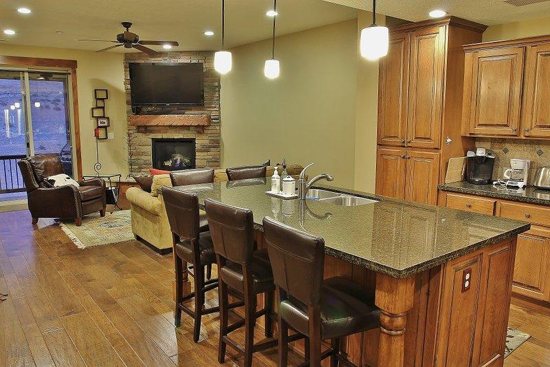 Vista de la cocina y sala de estar