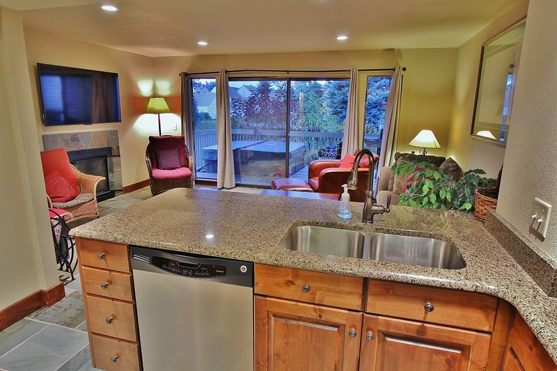 Living Room and view of Kitchen with barstools for seating up to 4 in Park City Racquet Club Village - Park City