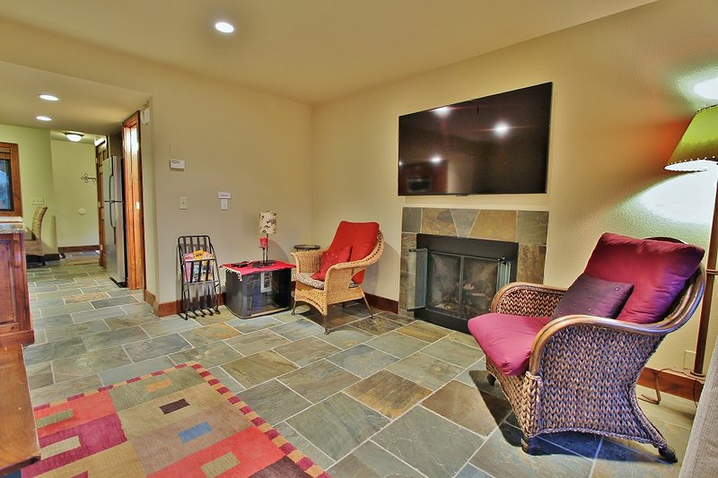Living Room with fireplace and 60' HD TV in Park City Racquet Club - Park City