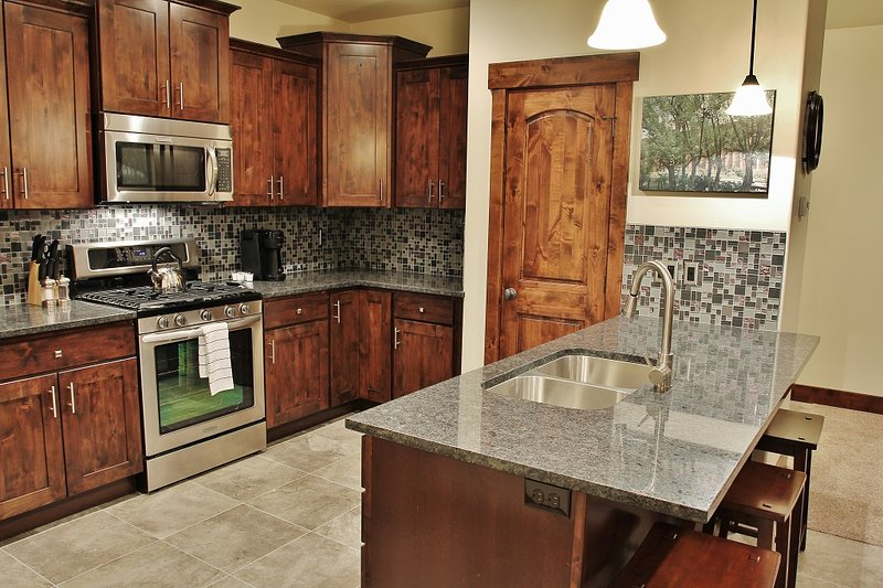 Park City Black Rock Ridge-Full stock Kitchen with Granite countertops and stainless steel appliances- Park City