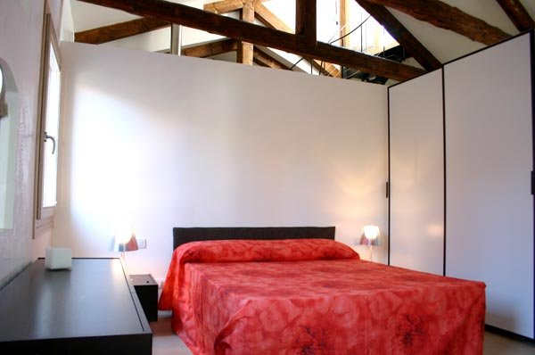 The master bedroom with bathroom and exit to balcony