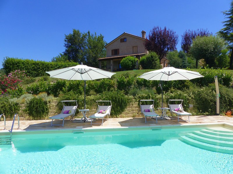 Relax by our lovely pool at Villa Miramonti