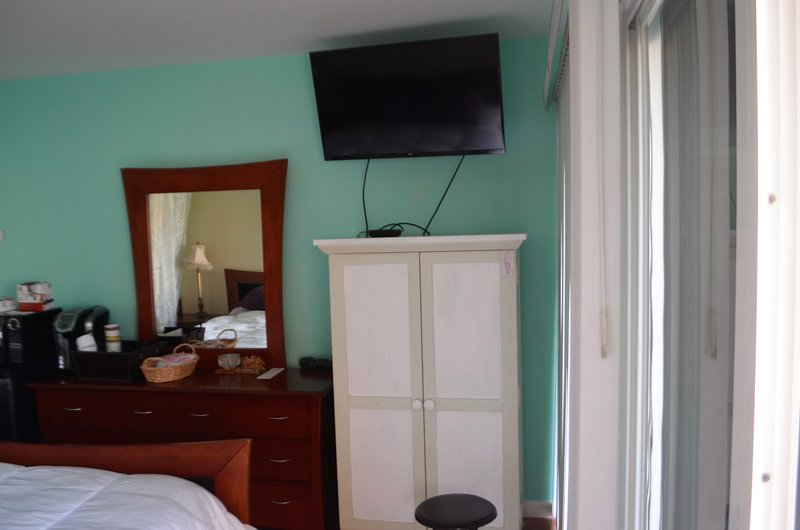 Premium cable TV.  Desk armoire is available for you and it has info on the wifi - or ask Host.
