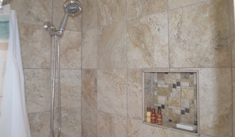 Newly built full bathrooom.  Complimentary shampoo, conditioner, lotion.  Ask host for more requests