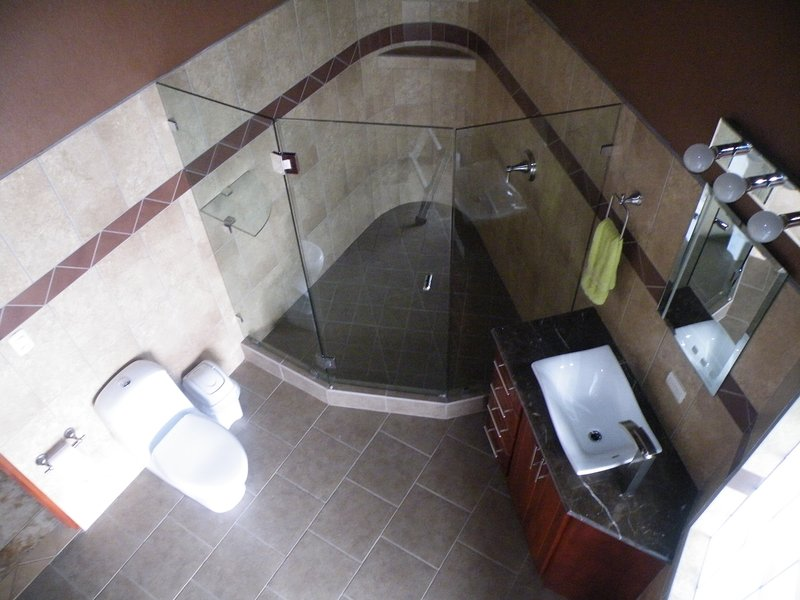 Large washroom with Huge glass shower also has outside entry by pool