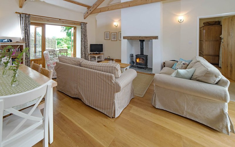 Living area with the cosy log burning stove.
