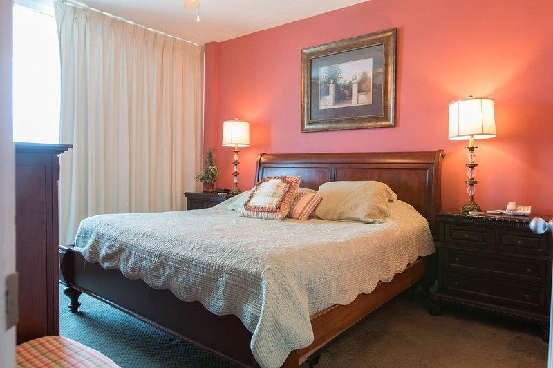 king size master bedroom with doors to ocean side balcony