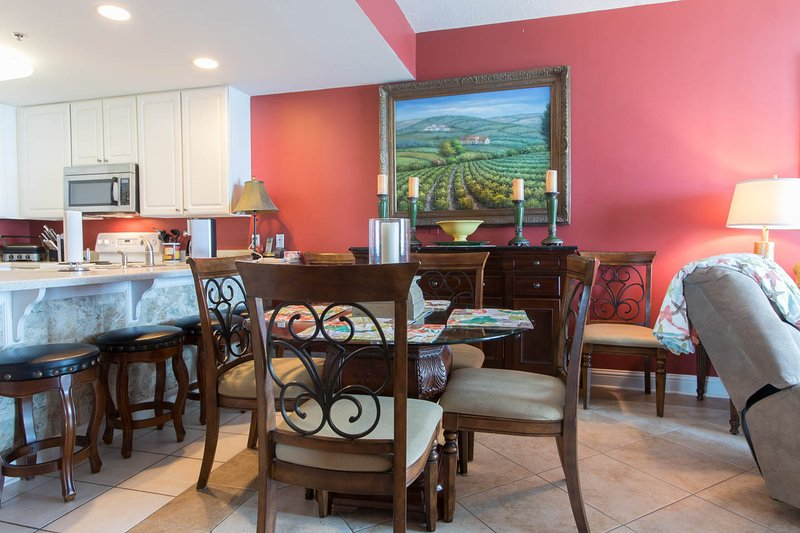 open layout dining room adjoins kitchen and living room