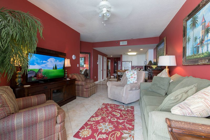 large HD tv and  i-pod ready stereo in comfortable living room with balcony access