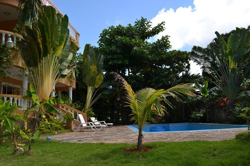 2-bedroom room on a large villa! Swimming Pool! Ocean view! Tropical garden., vacation rental in Sosua
