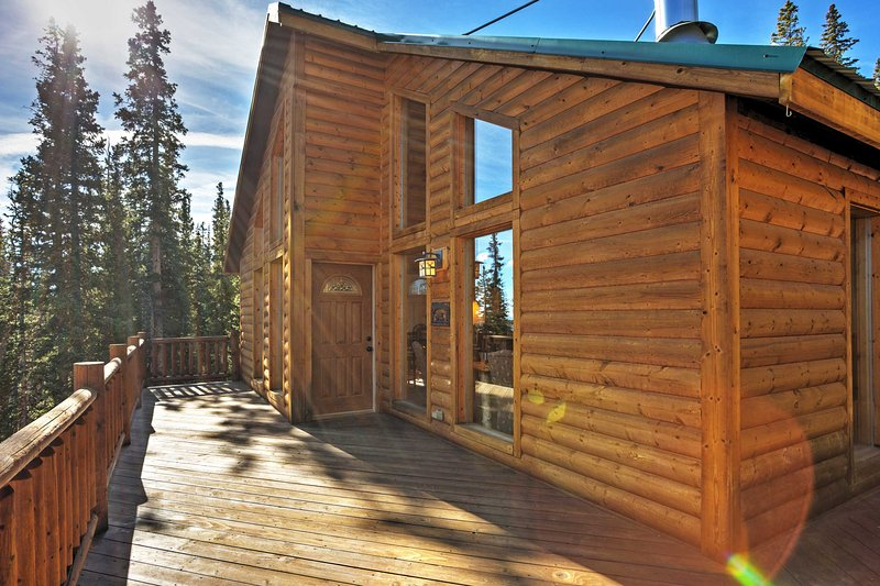 The private deck with wood accents provides immaculate views of the mountains in each direction.