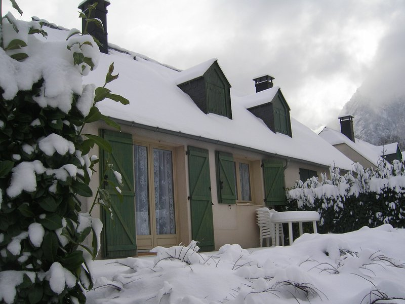 chalets and terrace under the snow