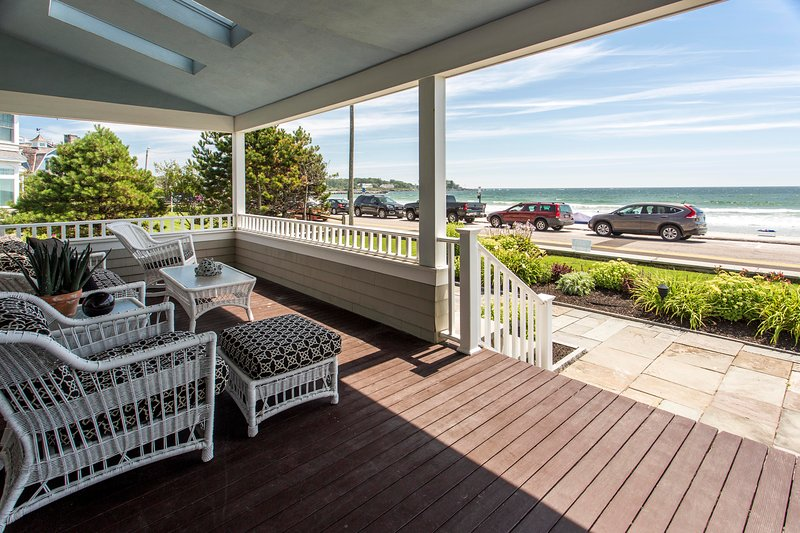 Relax on this picturesque front porch overlooking Gooch's Beach!