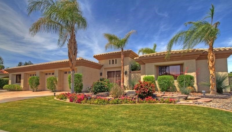 Custom home with 4 bedrooms, casita, pool, and spa in gated country club.