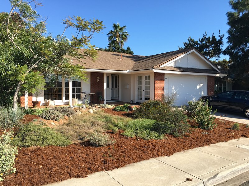 Front of house with California native landscaping and porch.