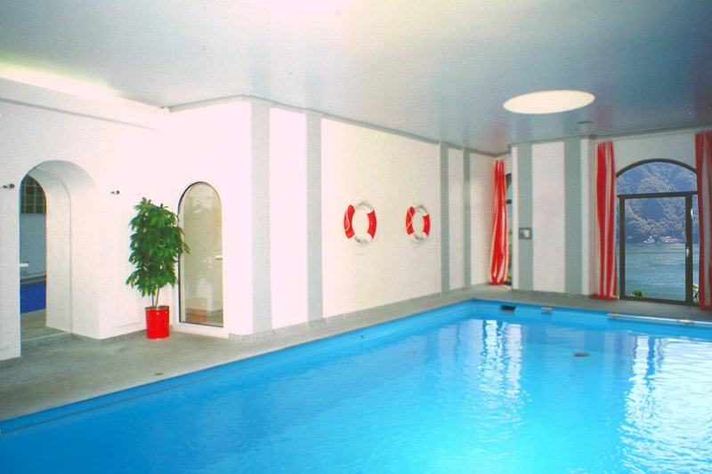 Shared indoor pool with open doors in summertime