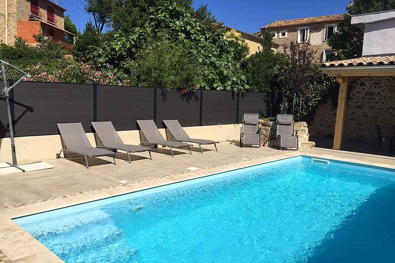 Pool area with sun loungers and seating