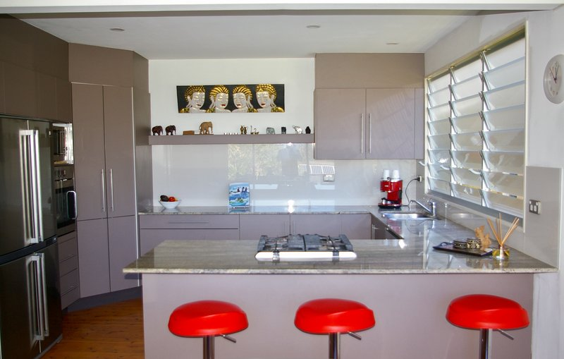 Kitchen with gas cooktop, electric wall oven, microwave, dishwasher, refrigerator, coffee machine