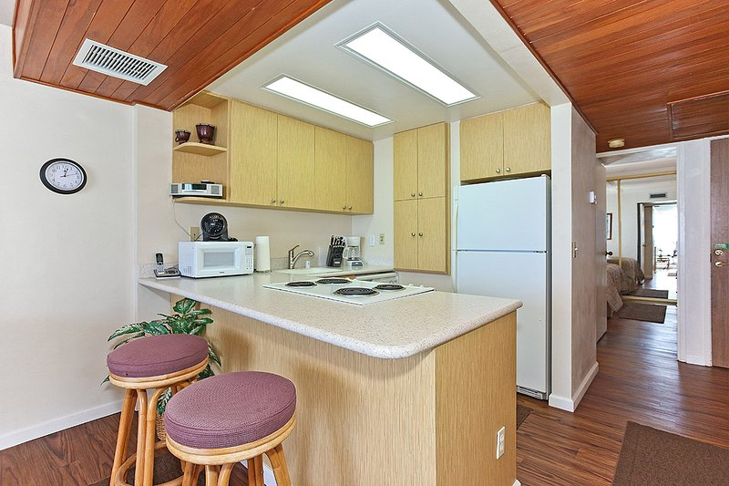 Kitchen with  a Breakfast Bar where You can Enjoy your Coffee