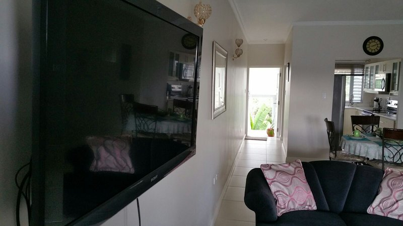 Open Planned Living & Dining Room with wall-mounted Flat Screen TV which is fully Air-Conditioned