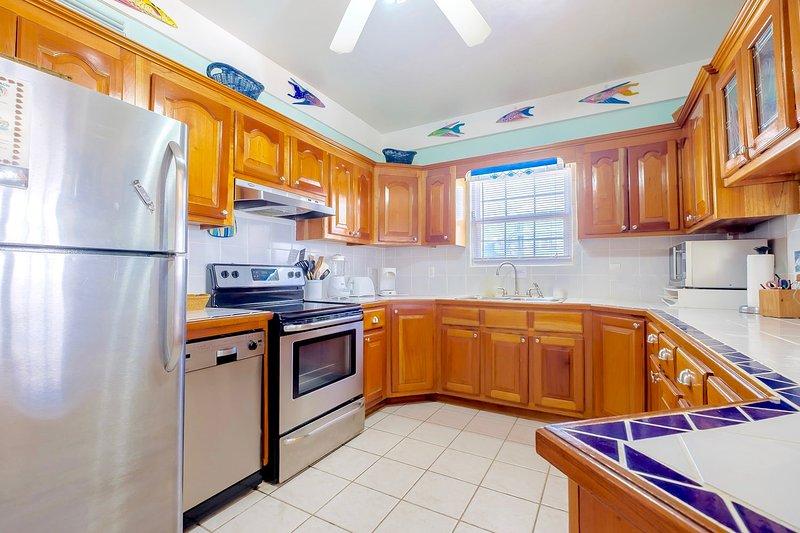 Voll ausgestattete Küche mit Theke Sitz