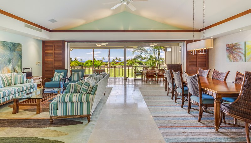 Palatial upstairs living and dining room open to main lanai with ocean view.
