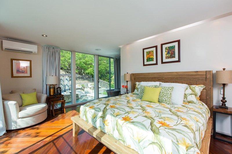 Master bedroom on third level, with en suite bathroom.