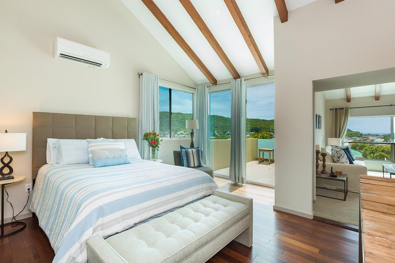 Bedroom four, a second-level master, with sitting room and en suite bathroom.