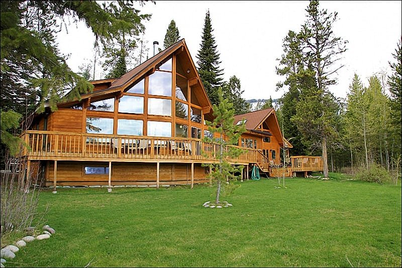 Lots of Windows bring Natural Light & Great Views. Wraparound Deck with Grill, Hot Tub, & loads of Outdoor Furniture.