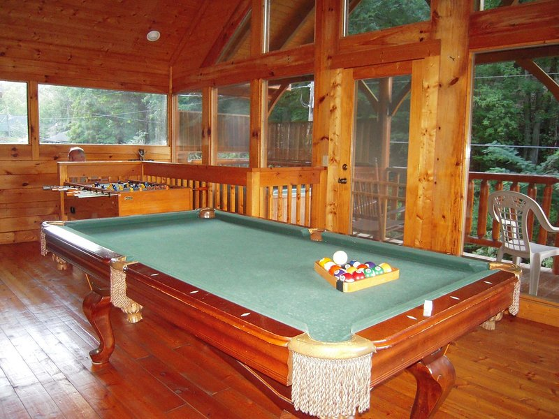 Enjoy the pool, foosball or and small game table all on the 2nd floor