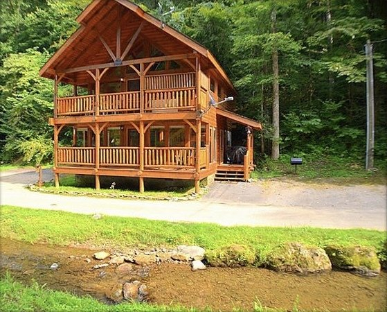 The cabin sits directly in front of a beautiful year round creek with minnows.
