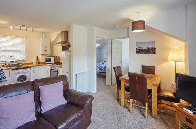 A modern and cosy apartment just yards from Brixham's bustling harbourside, holiday rental in Brixham