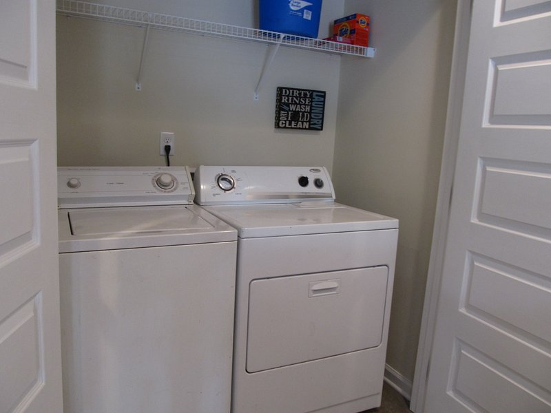 Washer and dryer located in the kitchen.