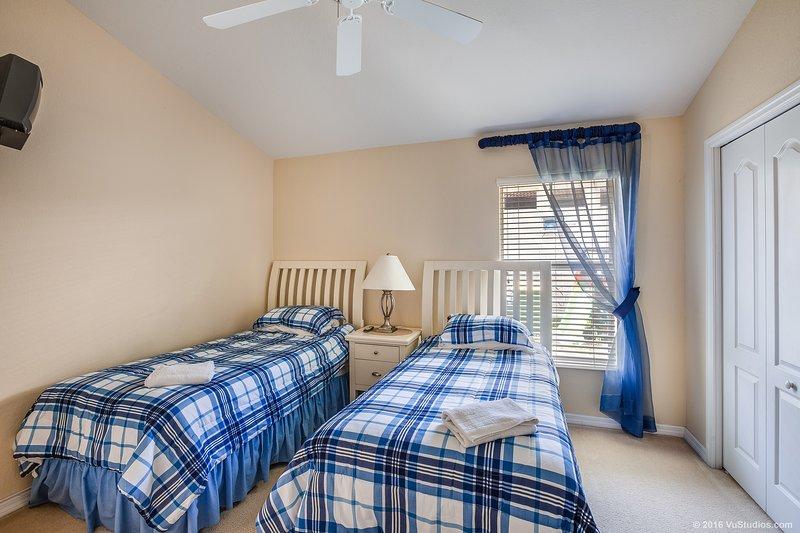 Cuarto dormitorio con dos camas individuales