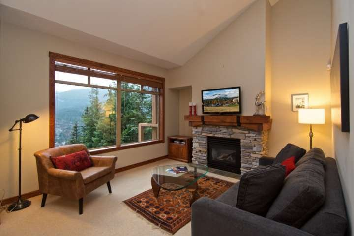 View of Whistler Creekside from living room windows. Gas Fireplace and wall mounted TV