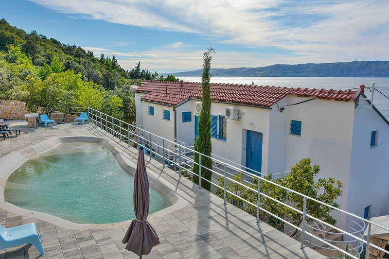 Fresh water, heated pool with a sea view right next to your apartment.