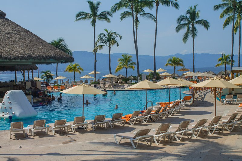 launches and sun umbrellas for our guests to enjoy around the pool