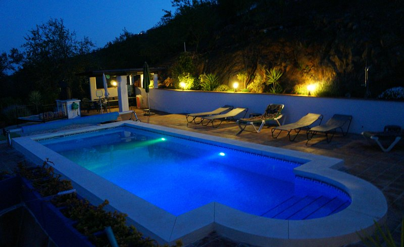 The lovely 8 x 4 m pool with it' s night lights on.