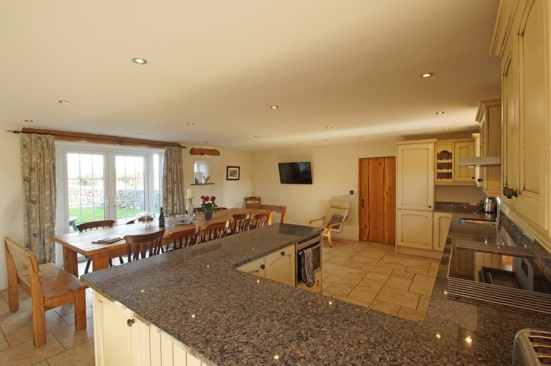 Beautiful open plan kitchen and dining room that you won't want to leave.