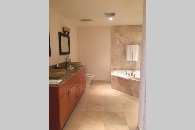 Positano Apt.~ full bathroom with jetted tub and jetted shower, double sinks