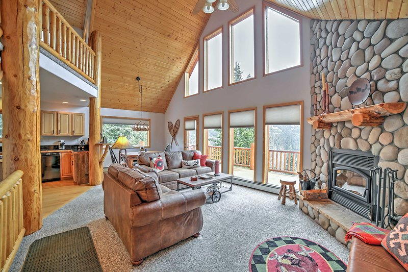 Large floor to ceiling windows flood the space with natural light.