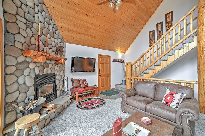 Cozy up around the fireplace after a long day on the slopes.